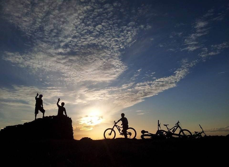 Image of mountain bikers in the sunset for Lee Quarry Trial Centre page on Visit Rossendale website