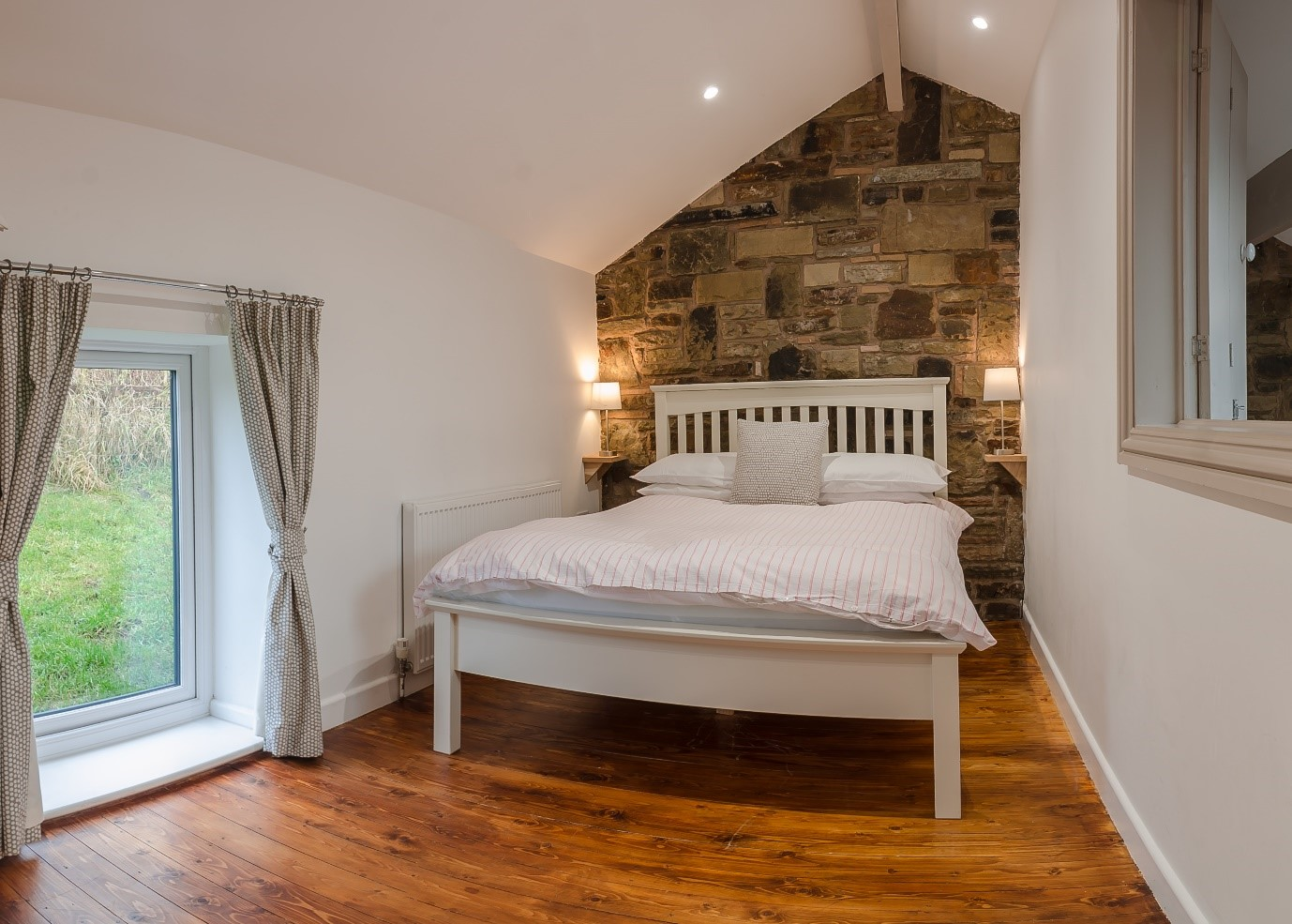 A cosy double bed at the Rossendale Holiday Cottages for Visit Rossendale website