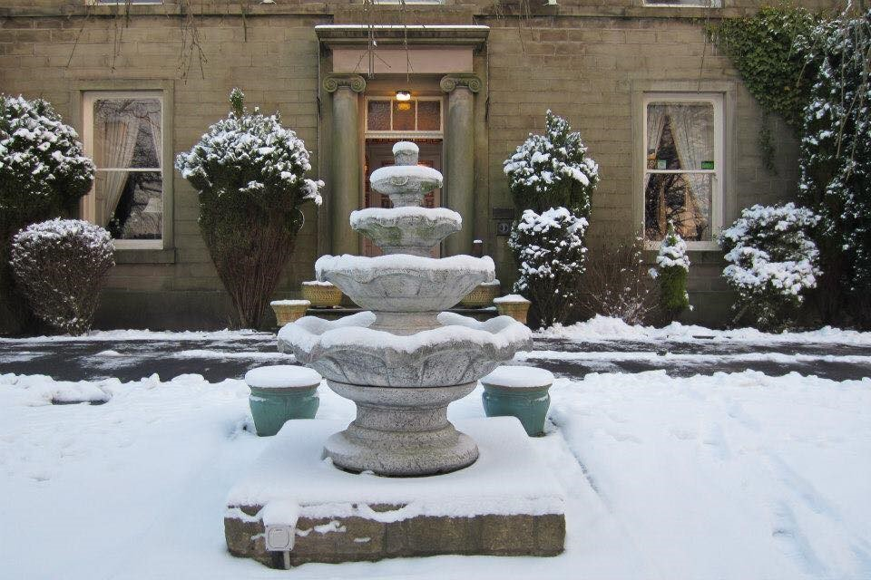 The fountain covered in snow at Sykeside Country House Hotel in Rossendale for Visit Rossendale website